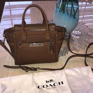Coach handbag with crossbody strap. NWT!